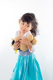 A beautiful young girl with her teddy bear Royalty Free Stock Photography