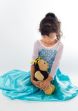 A beautiful young girl with her teddy bear Royalty Free Stock Photos