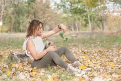 Beautiful young girl with her Yorkshire terrier dog puppy enjoying and playing in the autumn day in the park selective focus stock photo