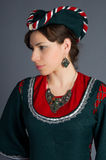 Beautiful young girl in a historical dress. On gray background Royalty Free Stock Photos