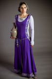Beautiful young girl in a historical dress Stock Photography