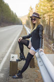 Beautiful young girl hitchhiking Stock Images