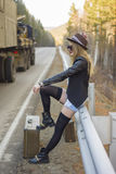 Beautiful young girl hitchhiking Royalty Free Stock Photos