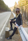Beautiful young girl hitchhiking Royalty Free Stock Photography