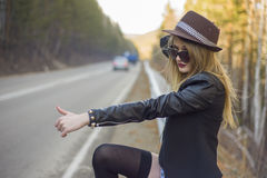 Beautiful young girl hitchhiking Royalty Free Stock Images
