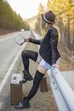 Beautiful young girl hitchhiking Stock Image