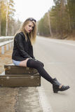 Beautiful young girl hitchhiking Royalty Free Stock Image