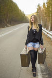 Beautiful young girl hitchhiking Stock Photography