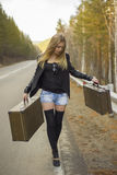 Beautiful young girl hitchhiking Stock Photos