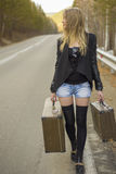 Beautiful young girl hitchhiking Stock Photo