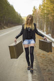 Beautiful young girl hitchhiking Royalty Free Stock Photos