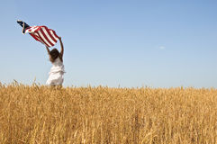 Beautiful young girl holding an American flag Royalty Free Stock Photo