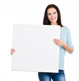 Beautiful young girl holding a banner Royalty Free Stock Photography