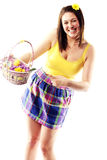 Beautiful young girl holding basket of eggs Royalty Free Stock Image