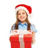 Beautiful young girl holding big Christmas present Royalty Free Stock Image