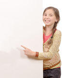 Beautiful young girl holding blank poster Royalty Free Stock Photos