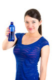 Beautiful young girl holding blue water bottle Stock Photos