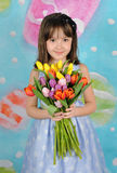 Beautiful young girl holding bouquet of tulips Stock Photography