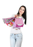 Beautiful young girl holding bright bags Stock Image