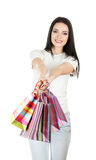 Beautiful young girl holding bright bags Royalty Free Stock Photography