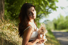 Beautiful young girl holding a bunny Stock Images