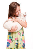 Beautiful young girl holding a cat. Stock Images