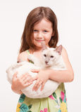Beautiful young girl holding a cat. Royalty Free Stock Photo
