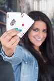 Beautiful young girl holding deck of cards Stock Images