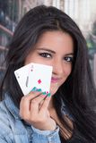 Beautiful young girl holding deck of cards Stock Photos