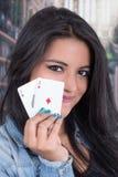Beautiful young girl holding deck of cards Stock Photos