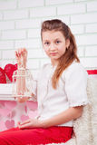 Beautiful young girl holding decorative cage Royalty Free Stock Image