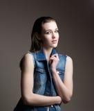 Beautiful young girl holding denim jacket Royalty Free Stock Photos