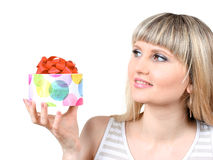 Beautiful young girl holding gift Royalty Free Stock Photo