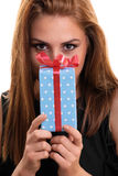Beautiful young girl holding a gift Stock Photo