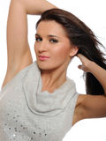 Beautiful young girl holding her long healthy hair Royalty Free Stock Photos