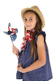 Beautiful young girl holding a patriotic pinwheel. Cute young brunette girl with brown eyes, a braid in her hair wearing straw hat holding a patriotic pinwheel Stock Photography