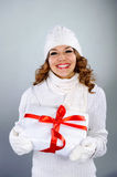 Beautiful young girl holding present box Royalty Free Stock Image