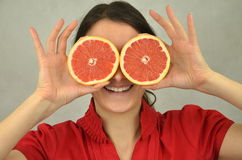 Beautiful young girl is holding a red grapefruit Stock Photo