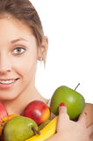 Beautiful young girl holding some. Fruits isolated on white background Stock Photo
