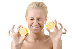 Beautiful young girl holding a sour lemon isolated Royalty Free Stock Photo