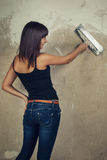 Beautiful young girl holding spatula over grunge Stock Image