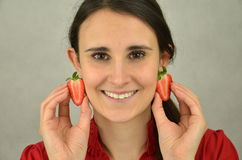 Beautiful young girl is holding strawberry Stock Photography