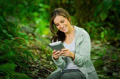 Beautiful young girl holding a tablet enjoying Royalty Free Stock Images