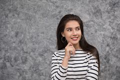 Beautiful young girl holing her finger up Royalty Free Stock Photos