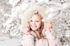 Beautiful young girl in a hood Royalty Free Stock Photos