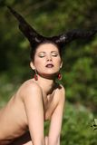 The beautiful young girl with horns like devil or angel Royalty Free Stock Images