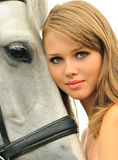 Beautiful young girl and horse Royalty Free Stock Photography