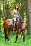 Beautiful young girl on horse Royalty Free Stock Photography