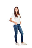 Beautiful young girl with jeans. Isolated on a white background royalty free stock photo