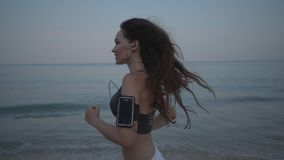 Beautiful girl jogging on the sandy beach Royalty Free Stock Photo